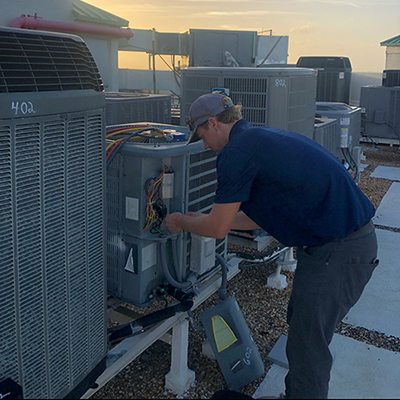 Treasure Coast Air Conditioning Team working on installations & maintenance of AC systems