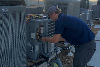 Treasure Coast Air Conditioning Team working on repairing and replacement issues & maintenance of AC systems