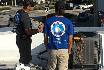 Treasure Coast Air Conditioning Team working on repairs & maintenance of AC systems