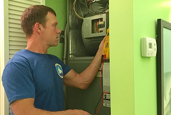 Treasure Coast Air Conditioning Team working on troubleshooting issues & maintenance of AC systems